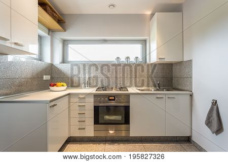Small Kitchen With White Walls
