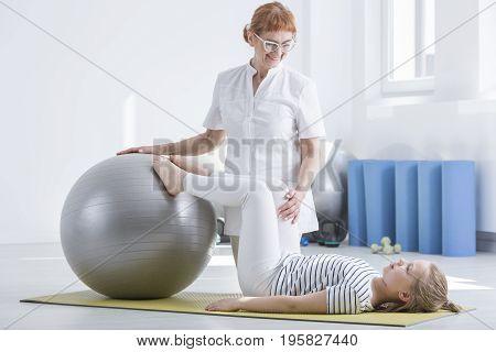 Child Orthopedist Using Gym Ball