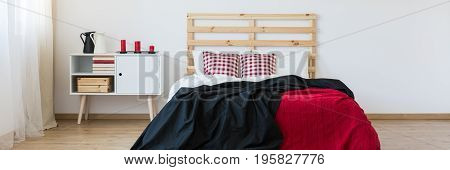 Bedroom With Red Accessories