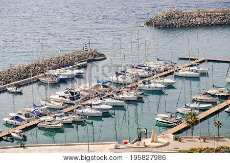Mgarr, Malta - October, 2014: ships and boats in the Port of Mgarr