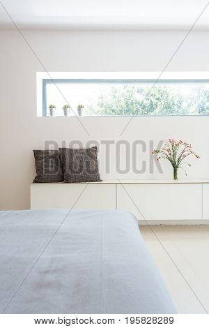 White Cabinet And Horizontal Window