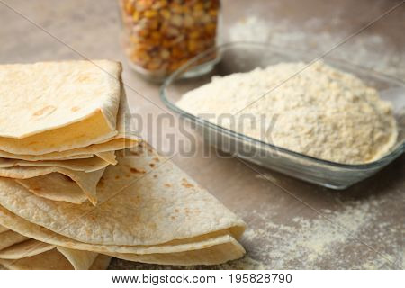 Composition with yummy tortillas on kitchen table