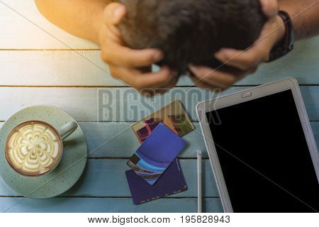 Man with financial problems and credit card or Man are stressed with credit card .