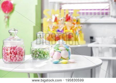 Different sweets in jars at candy shop