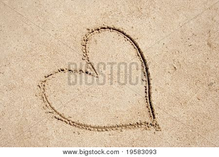 Heart shape drawn in sand for natural, symbol,tourism,holiday or conceptual designs