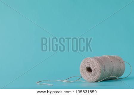 Spool With Twine Isolated On Aquamarine Background