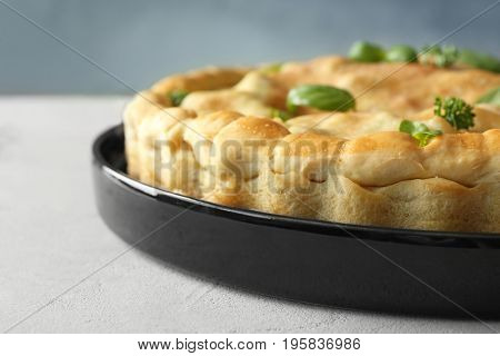 Baking dish with turkey pot pie on table, closeup