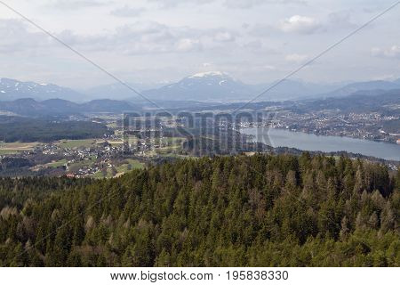 Panoramic view of Woerthersee lake mountain peaks and valleys