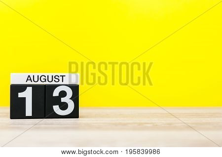 August 13th. Image of august 13, calendar on yellow background with empty space for text. Summer time.