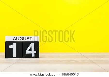August 14th. Image of august 14, calendar on yellow background with empty space for text. Summer time.