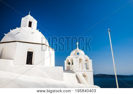 Santorini, Cyclades Islands, Greece. White church in Thira, the main town of the island.