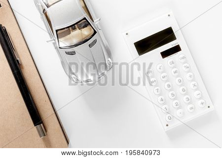 Choosing car concept. Toy cars and bank card on white background top view copyspace.