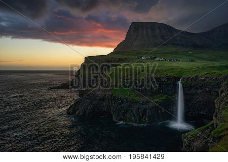 Gasadalur village and Mulafossur waterfall in sunset Faroe Islands