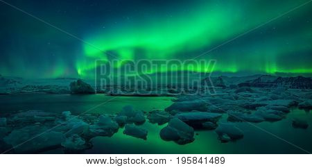 Aurora borealis above Jokulsarlon glacier lagoon Iceland