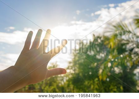 Sun blind with hand in hot summer - heat concept