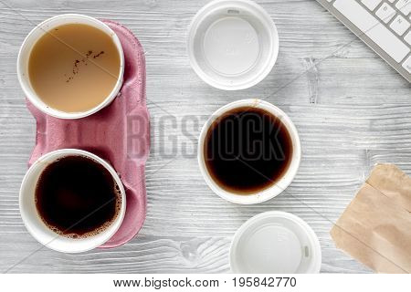 Coffee to go. Coffee cups on wooden table backound top view.