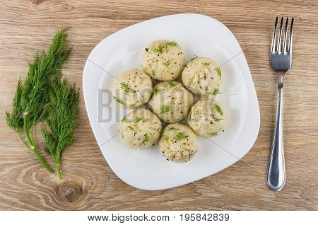 Boiled Khinkali With Dill In White Plate And Fork