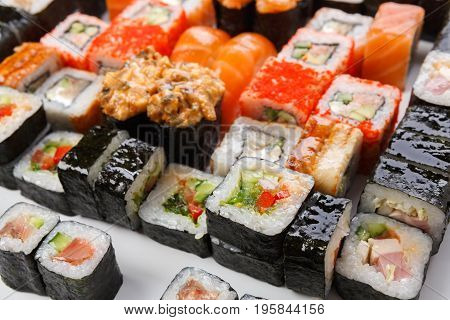 Japanese food restaurant delivery. Sushi and rolls pattern background. Salmon, unagi, california and other colorful healthy meals