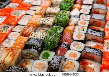 Sushi and rolls pattern background, japanese restaurant delivery closeup. Salmon, unagi, california and other healthy meals