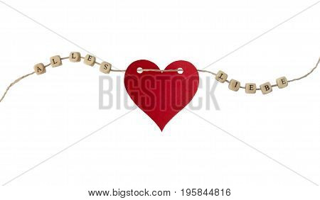 The german words for all love and a heart on a cord, isolated on white