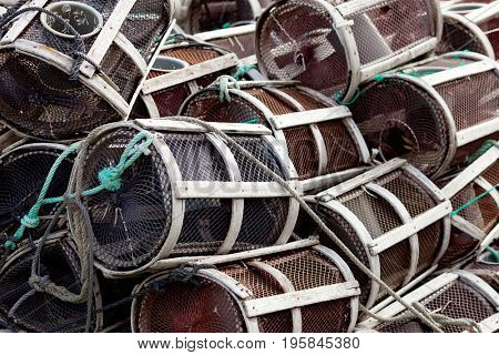 Many octopus traps stacked at the port