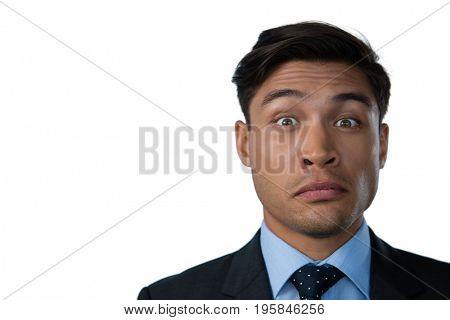 Close up portrait of businessman making a face against white background