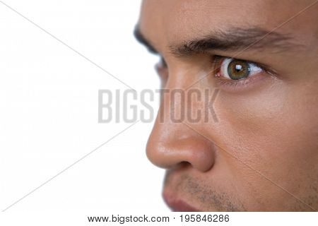 Close up of angry businessman looking away against white background