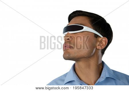 Close up of young businessman using smart glasses against white background