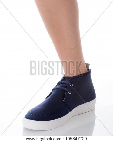 Man foot wearing blue fashion shoes in hipster style standing with side view Isolated on white background Men's Fashion concept.