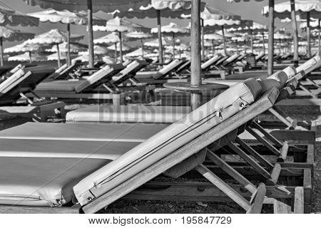 big sunbeds on the beach closeup of monochrome tone