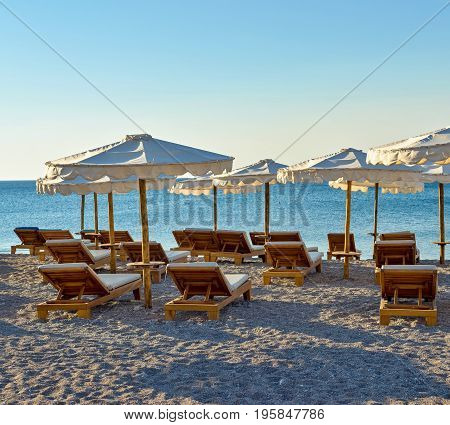 sea beach landscape with sunbeds and sunshades