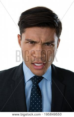Portrait of displeased businessman against white background