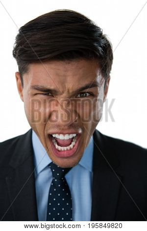 Portrait of frustrated businessman against white background