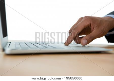 Cropped hand on businessman touching touch pad against white background