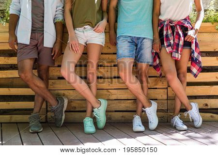 Cropped picture of young multiethnic friends students standing outdoors.