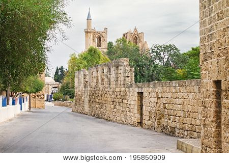 Ancient street to mosque, Gothic St. Nicholas Cathedral in town Famagusta, North Cyprus
