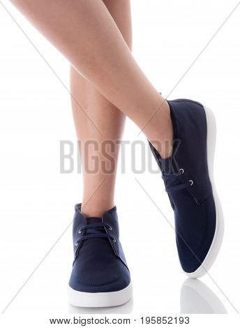 Man feet wearing blue fashion shoes in hipster style, crossing legs pose, Isolated on white background, Men's Fashion concept.