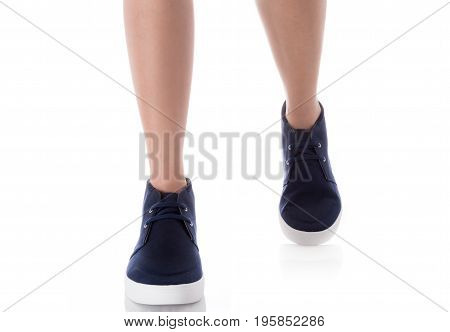 Man feet wearing blue fashion shoes in hipster style Step with front side Isolated on white background Men's Fashion concept.