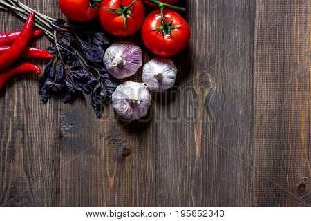 Prepring for cooking dinner. Vegetables on wooden table background top view.