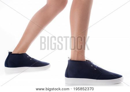 Man feet wearing blue fashion shoes in hipster style step with side view Isolated on white background Men's Fashion concept.