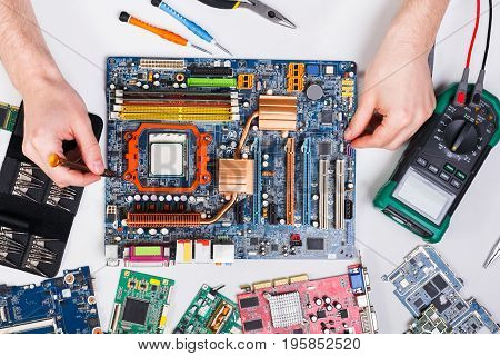 Motherboard. Maintenance support and repairing service concept. Technician upgrade of computer top view.