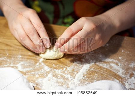 woman is preparing a dough in the kitchen