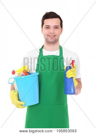 Young man with cleaning products on white background