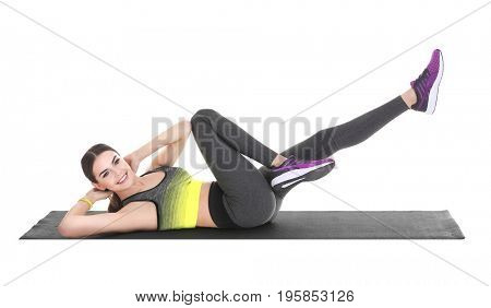 Young woman doing bicycle crunch exercise on white background