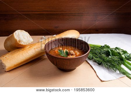Borsch - Traditional Ukrainian And Russian Red Beetroot Soup With Red Beets In Clay Bowl On Wooden B