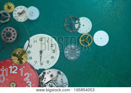 Creative composition with parts of mechanical clock on grunge background