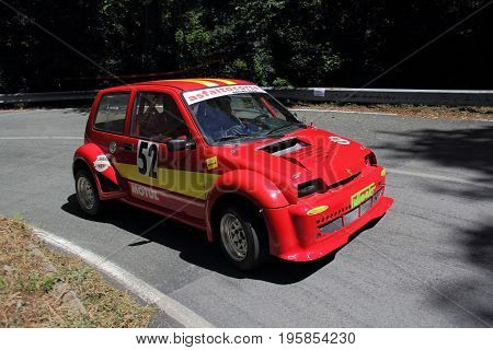 Favale di Malvaro Italy - July 16 2017: Speed Racing uphill Favale Castello: The Fiat 500 Sporting prototype conducted by Giuseppe Pugliese in action on the route.