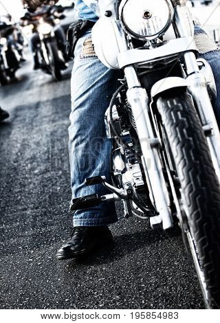 Image of bikers riding motorbikes, closeup photo of male drive motorcycle, motorsport, active people, freedom lifestyle, biker parade, stainless steel detail and tire of motorbike