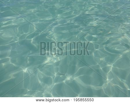 Reflection of the sun on crystalline Caribbean beaches