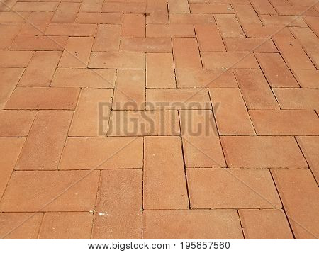 many rectangular red brick tiles on the ground